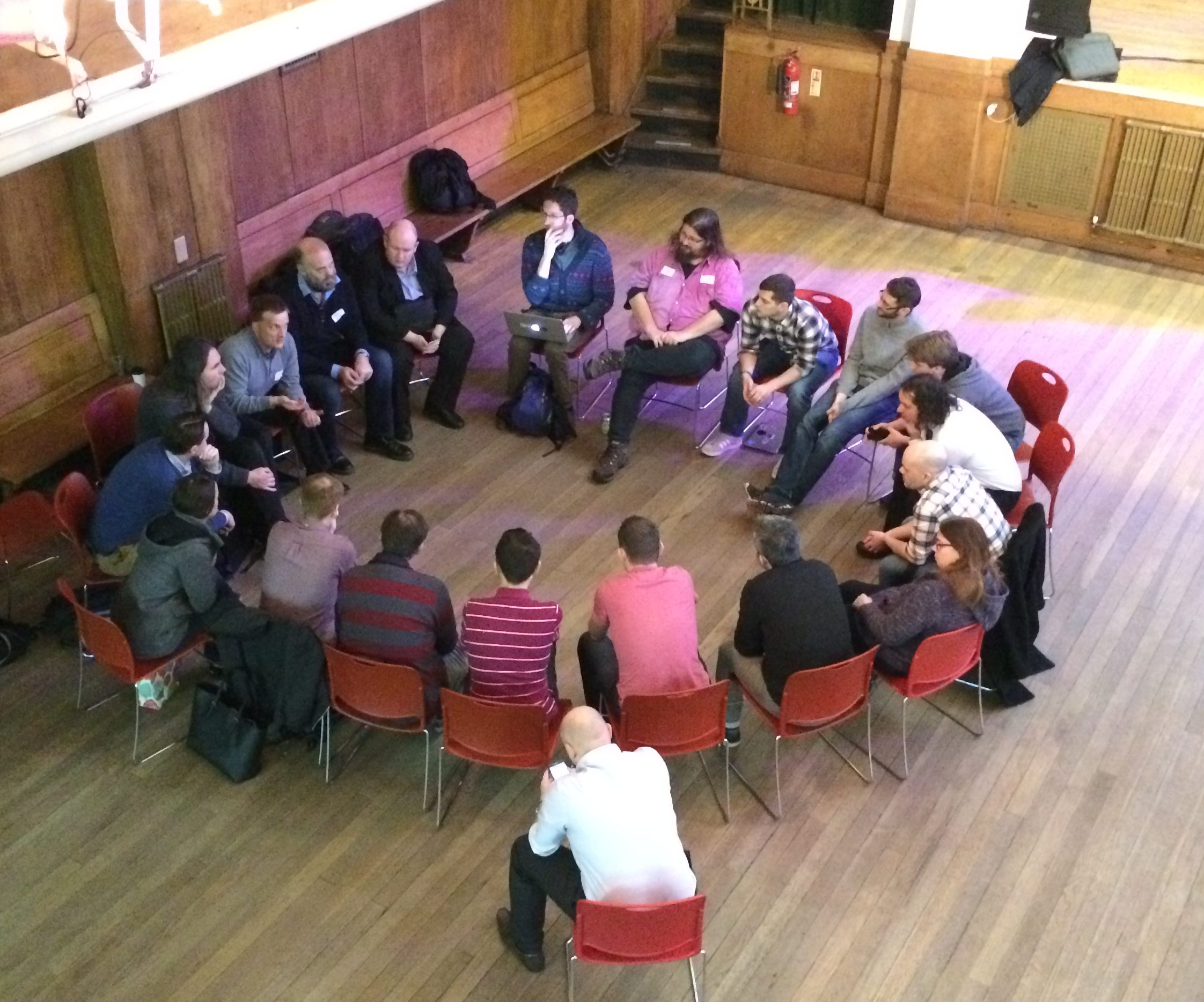 Attendees sitting in a discussion circle