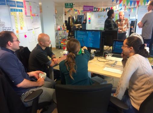 Junior developers working on code