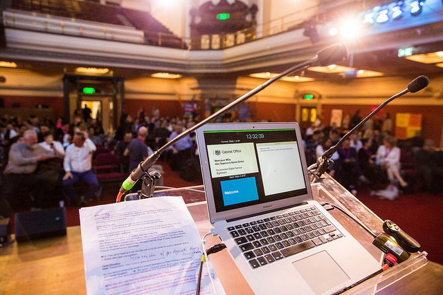 Laptop and notes at a lectern