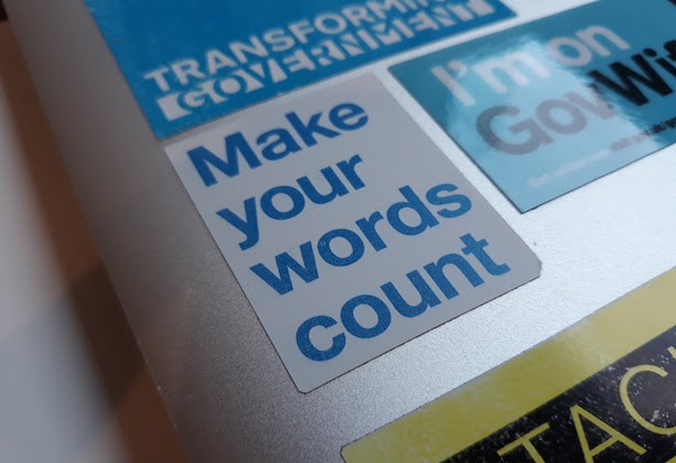 A laptop with a sticker saying make your words count